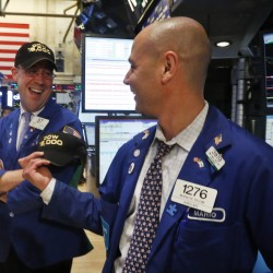Dow ends at another record close as cyclicals rally