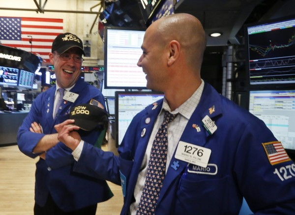 Traders Jarrett Johnson (R) and Mario Picone share a laugh after the Dow Jones Industrial average surpassed 15,000 during the trading day on the floor at the New York Stock Exchange, May 3, 2013.  Stocks climbed on Friday, with the S&P 500 and Dow industrials hitting intraday record highs after U.S. employment rose more-than-expected in April, easing concerns about weak economic growth.