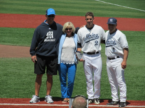 University of Maine senior co-captain Mike Fransoso (second right) poses with his parents (from left) Rick and Patti, along with Black Bears coach Steve Trimper, prior to last Saturday's game in Orono.