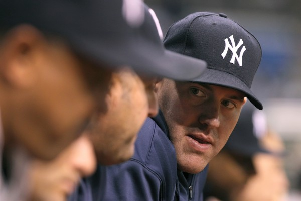 New York Yankees third baseman Kevin Youkilis (36) in the dugout against the Tampa Bay Rays at Tropicana Field in April.