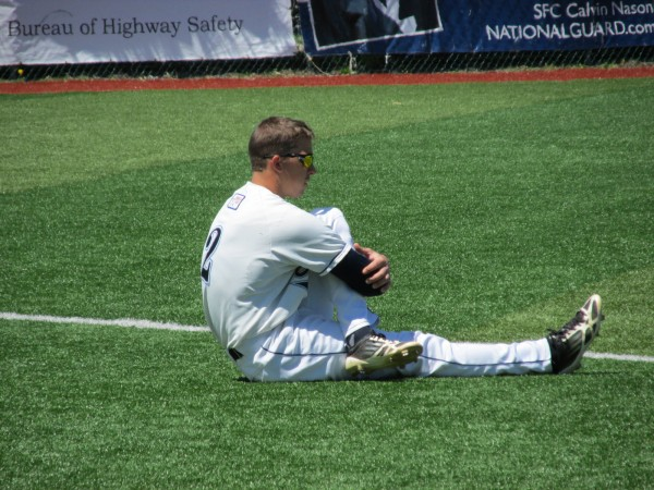 Mike Fransoso of the University of Maine baseball team stretches his troublesome right hip prior to his final home game last Saturday at Mahaney Diamond in Orono.