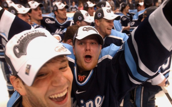 The Univerisy of Maine's Derek Damon (left) and Jon Jankus (center) celebrate the Black Bears victory over Michigan State University in the NCAA East Regional final gave at the Pepsi Arena in Albany, N.Y., in March 2006.