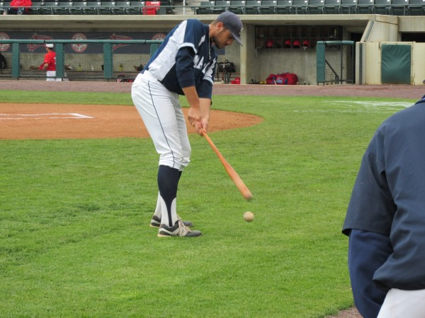 Luke Morrill of the University of Maine simulates a golf swing with a baseball bat as the Black Bears waited to play Friday's America East tournament game against Stony Brook.