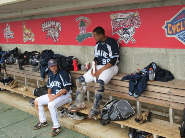 Scott Heath (left) and Jonathan Salcedo of the University of Maine share some down time in the University of Maine dugout prior to Friday's America East elimination game against Stony Brook at Lowell, Mass.