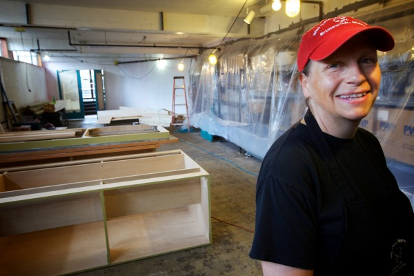 Becky Shepherd, owner of Wild Oats Bakery and Cafe in Brunswick, stands in additional being renovated for kitchens Thursday. The popular eatery may soon open a satellite location across town at the former U.S. Navy base.