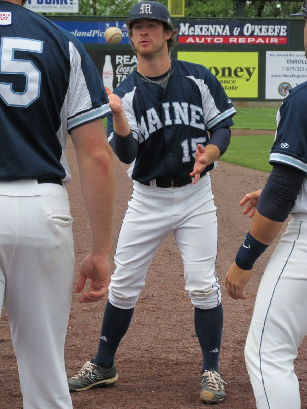 UMaine pitcher Steve Trask plays a game with his teammates as they try to stay loose in preparation for Friday afternoon's America East tournament game against Stony Brook.
