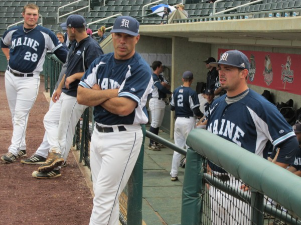 University of Maine head coach Steve Trimper (left) chats with pitcher Tommy Lawrence prior to Friday afternoon's America East tournament game at Lowell, Mass.