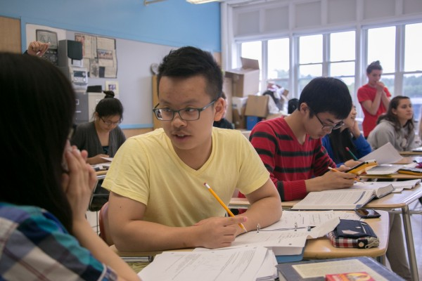 Chinese students Michael Gao (right) and Mindy Yi discuss their practice exam during their AP statistics class at Orono High School on Thursday, May 9, 2013.