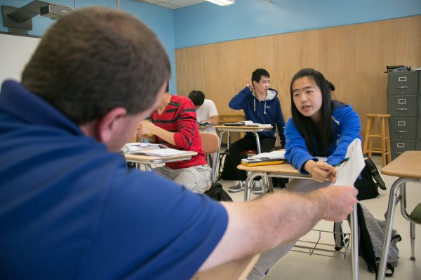 Chinese student Michelle Xiang asks her AP statistics teacher Chris Libby a last-minute question before their exam the next day at Orono High School on Thursday, May 9, 2013.