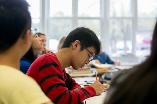 Chinese student David Li looks over his practice AP statistics exam at Orono High School on Thursday, May 9, 2013.