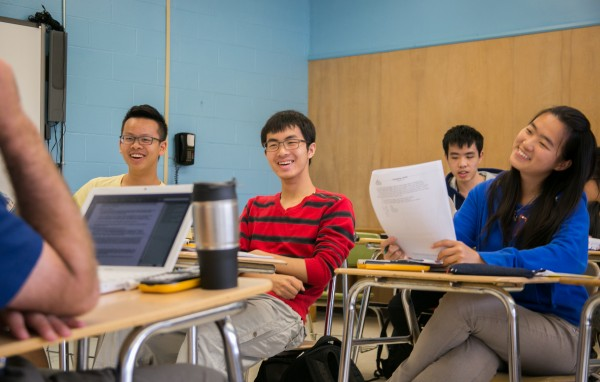 Chinese students Michael Gao (from left), David Li and Michelle Xiang ask last minute questions before their AP statistics exam at Orono High School on Thursday, May 9, 2013.