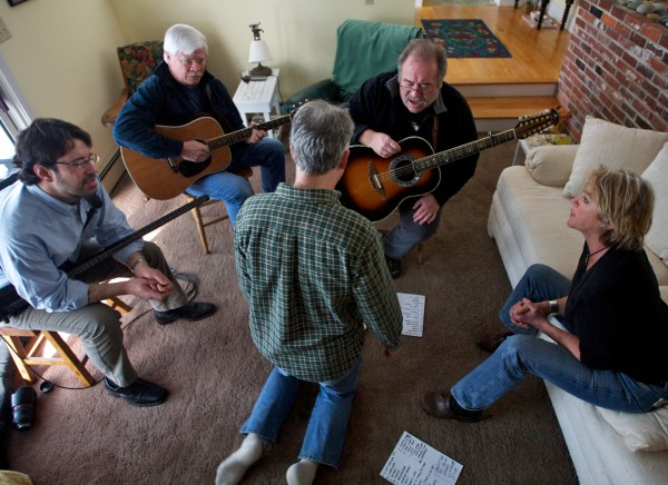 Leaning in close to get a harmony part worked out (from left) Dave Rowe, Seve Romanoff, Tom Dyhrberg, Chuck Romanoff and Alana MacDonald rehearse in Scarborough on March 4, 2012, for the 34th annual Schooner Fare/Devonsquare reunion show. The yearly event brings members of both related folk bands together to raise money for the Jack McPhillips Memorial Fund.