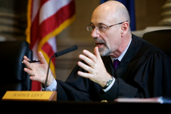Judge Jon D. Levy of the Maine Supreme Judicial Court speaks Tuesday in Portland to arguments in the appeal of Jeffrey Cookson, who was previously convicted of murdering Mindy Gould, 20, and 21-month-old Treven Cunningham in December 1999.