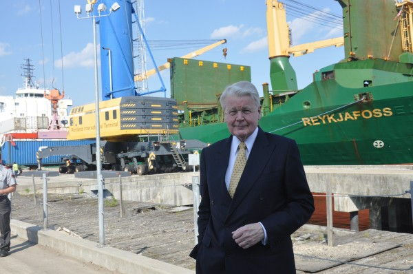 Olafur Grimsson, president of Iceland, stands at Portland's International Marine Terminal with an Icelandic ship belonging to Eimskip gets loaded with containers. Grimsson was in Portland on Friday for Maine International Trade Day, where he gave the keynote address.