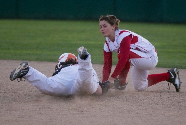 Brewer's Cassie Harvey (left) is tagged out trying to slide into second base by Cony's Maggie Russell on Tuesday, May 28, 2013.