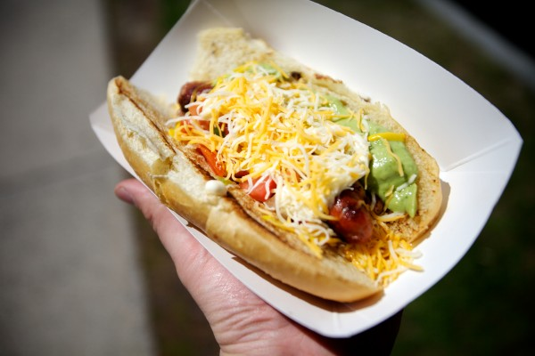 A Sonoran hot dog from the El Corazon food truck in Portland topped with bacon, cheese, pinto beans, pico de gallo, guacamole, mayo and mustard.