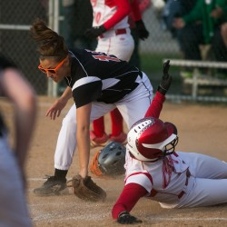 Cony's Margaret Russell (right) slides safely into home plate against Brewer's Alexa Grindle on Tuesday, May 28, 2013.