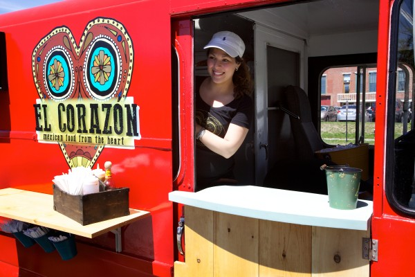April Garcia greets customers in her El Corazon food truck on Spring Street in Portland on Wednesday.
