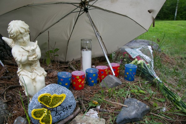 Community members left messages and candles at a memorial dedicated to Nichole Cable near her home in Glenburn on Tuesday.