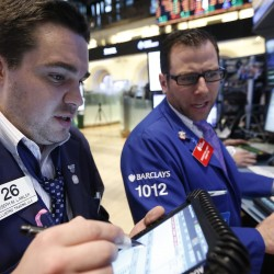 Dow surges to new record closing high on economy, Fed's help
