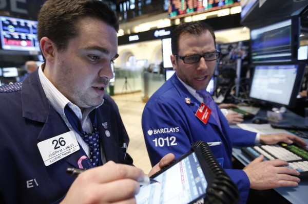 Traders work on the floor at the New York Stock Exchange, May 7, 2013.