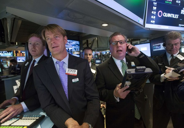 Traders work on the floor at the New York Stock Exchange, May 15, 2013.