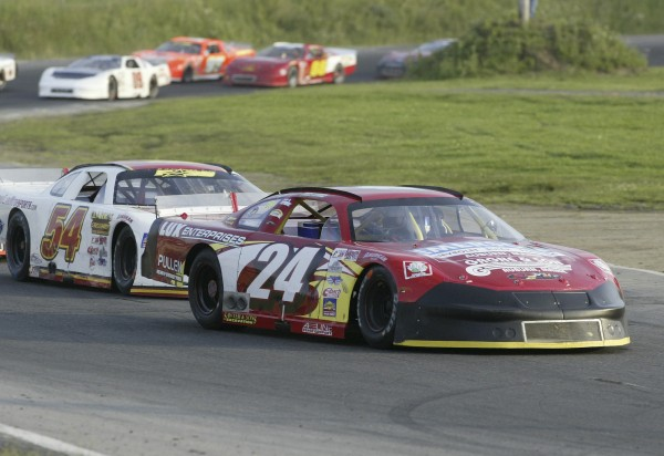 Mike Rowe (24) of Turner stays ahead of Johnny Clark (54) of Hallowell during the Budweiser 150 Pro All-Stars Series feature at Unity Raceway in July 2005.