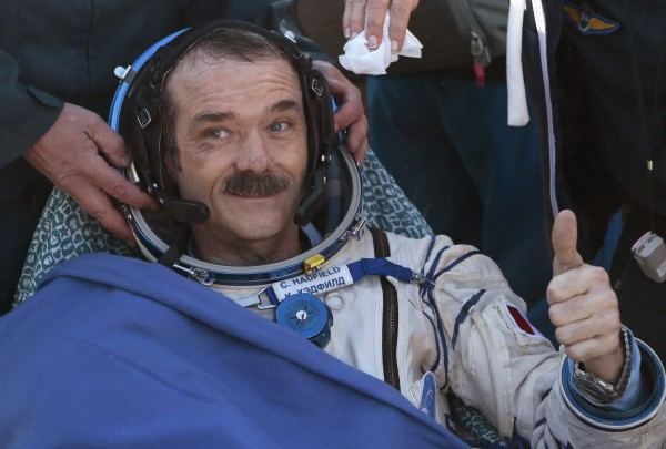 Canadian astronaut Chris Hadfield gestures with a thumbs up after the Russian Soyuz space capsule landed some 90 miles southeast of the town of Zhezkazgan, in central Kazakhstan May 14, 2013.