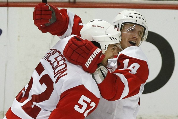 Detroit Red Wings' Gustav Nyquist (right) celebrates with team mate Jonathan Ericsson after scoring in overtime against the Anaheim Ducks during Game 2 of their NHL Western Conference quarter-final hockey playoff in Anaheim, Calif., May 2, 2013.