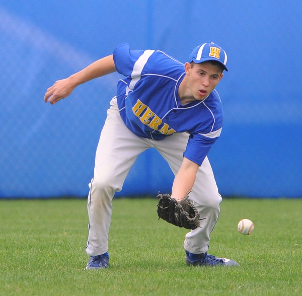 Hermon's Tyler Thayer makes a catch in the outfield during the game against MDI in Hermon Thursday.
