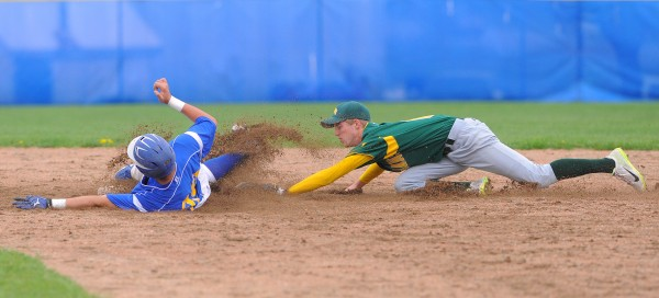 MDI's Jon Phelps (right) can't tag Hermon's Joey Martin as he slides to second base during the game in Hermon Thursday.