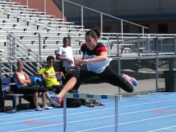 Jesse Labreck, University of Maine, Orono track and field heptathlete, jumps a hurdle Tuesday afternoon at UMaine.