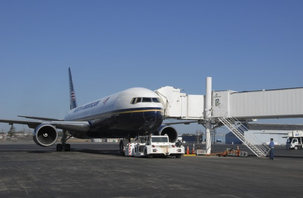 A North American Airlines Boeing 767 is serviced at Bangor International Airport in March 2012. Government and airline reporting systems have logged dozens of cases in which passenger electronics were suspected of interfering with navigation, radios and other aviation equipment.