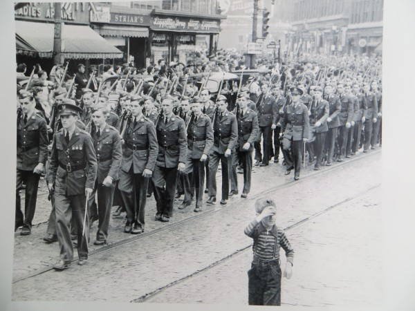 This photo originally was published in the BDN in 1942.  Donald Gallupe, age 18, marches at the very front corner (left side of the photograph) of his ROTC group from Bangor High School in the  Memorial Day parade in downtown Bangor.