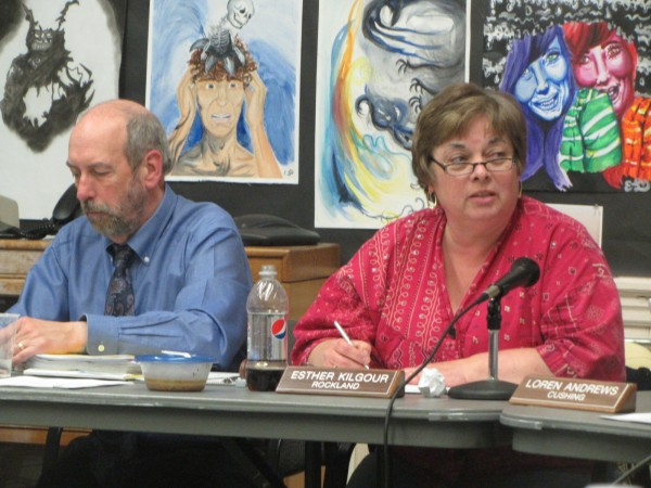 Regional School Unit 13 Superintendent Lew Collins (left) and board Chairwoman Esther &quotTess&quot Kilgour listen to debate on the proposed merger of the district's two middle schools in April.
