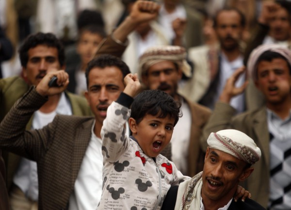 A boy shouts slogans during a demonstration against Israeli air strikes in Syria, in Sanaa May 10, 2013.
