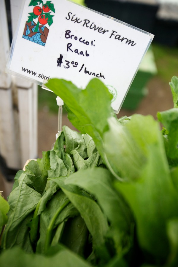 Spring greens are fresh at the Six River Farm stand at the Brunswick Farmers Market Tuesday morning.