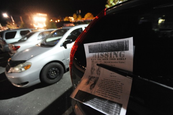 A missing person poster soliciting the help of the public in finding Glenburn teen Nicole Cable rests under the rear wiper of an SUV in a parking lot during the Motley Crue show at the Bangor Waterfront on Thursday.
