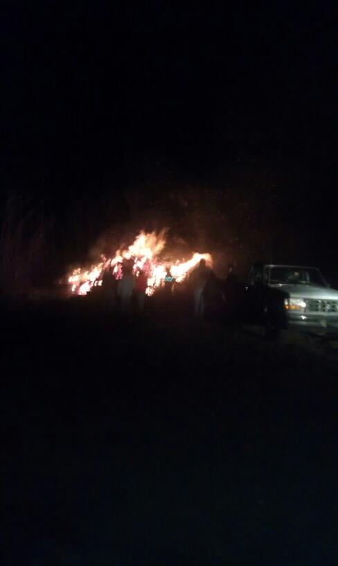 Firefighters battle a blaze at a dairy farm on Stetson Road in Kenduskeag Thursday night.