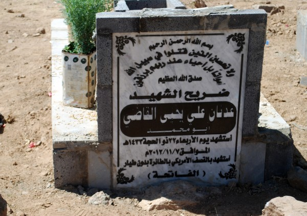 This is the gravestone of Adnan al Qadhi who was killed in a U.S. drone strike in the village of Beit al Ahmar, Yemen, on November 7, 2012. The grave stone described him as a martyr and noting his death &quotby American drone,&quot but makes no apparent reference to his alleged ties to Al Qaida in the Arabian Peninusla. Family and neighbors believe Qadhi, a prominent local figure, could have been captured alive but doubt he was doing anything clandestine on behalf of AQAP.