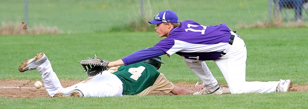Hampden's Sam Ward stretches out to try and nab a pick-off gone awry as Ben Bowie makes it back to first safely in Paris on Friday. Due to the error, Bowie was able to make it to third base before being stopped. The Vikings won 4-1.