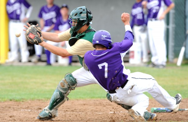 Hampden's Logan Steward barely makes it past Oxford Hills catcher Jordan Crouteau to score the Broncos' one and only run during their game Friday in South Paris. The Vikings won 4-1.