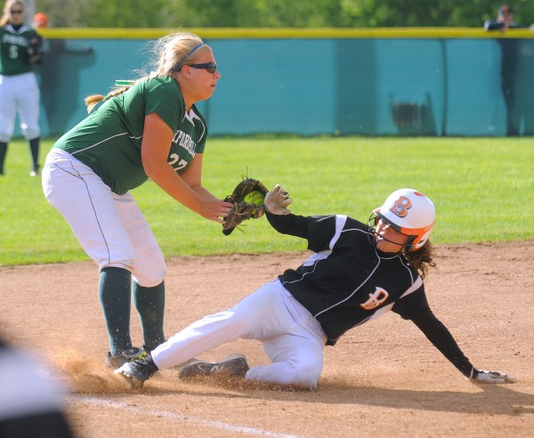 Brewer's Emily Gilmore (right) slides to third base, beating the tag by Oxford Hills' Jordyn Sanborn during the game in Brewer on Friday. Gabor Degre / BDN