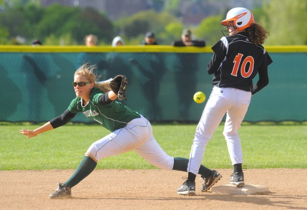 Brewer's Emily Gilmore (right) was safe at second base as the throw to Oxford Hills' Abby Bernier goes wide during the game in Brewer on Friday. Gabor Degre / BDN