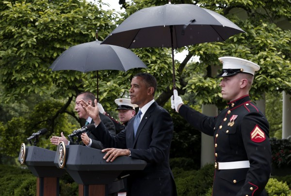 U.S. Marines hold umbrellas as rain falls during a joint news conference between President Barack Obama and Turkish Prime Minister Recep Tayyip Erdogan in the White House Rose Garden in Washington, May 16, 2013.