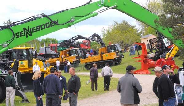 People look around during the 2013 Northeastern Forest Products Equipment Expo, which started Friday. The expo features a variety of items from the most simple hand tools to huge computerized forestry equipment. Show manager Joe Phaneuf said that people can find almost anything related to wood, boilers, firewood processors, logging trucks and sawmills at the expo. Exhibitors came from all over the U.S. and Canada as well as England and Eastern Europe. Over the years the Northeastern Forest Products Equipment Expo has grown into the largest of its kind in the country, drawing people from all over New England and eastern Canada. In its 30-year history, this is the 13th time the show has been in Bangor, as it alternates locations with Essex Junction, Vt.  The show will be open 9 a.m. to 4 p.m. Saturday