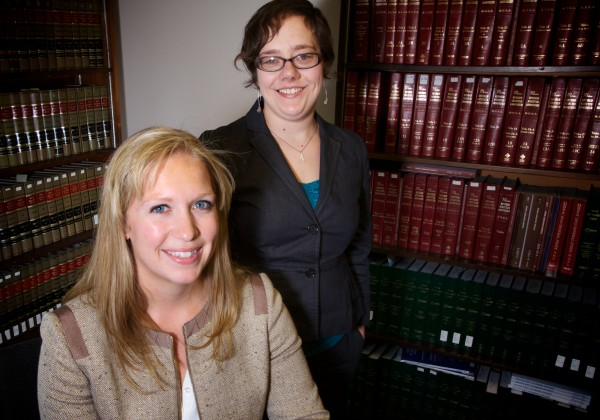Jessica Currier (left) and Allison Ouellet are returning to their home counties in Maine after graduating from the University of Maine School of Law.