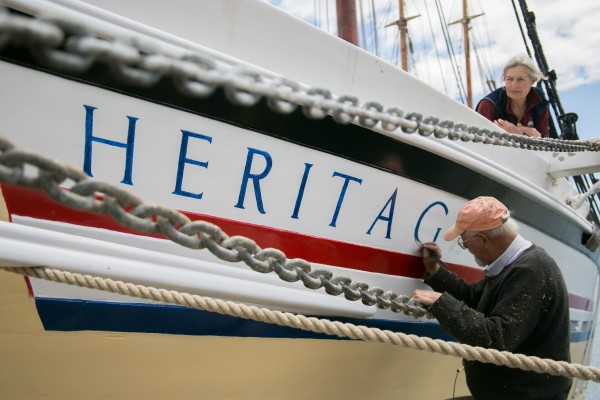 Douglas Lee and his wife, Linda, finish a fresh paint job on their coasting schooner the Heritage in Rockland on Friday.