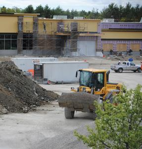 The new Market Basket supermarket is shown under construction Friday. The store plans to open this summer and is accepting applications for 300 openings