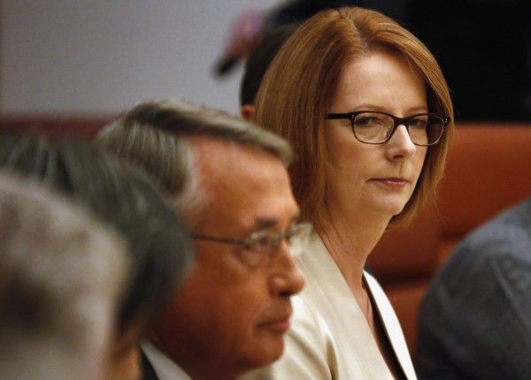 Australian Prime Minister Julia Gillard (R) looks towards Treasurer Wayne Swan during a meeting at Parliament House in Canberra May 13, 2013.